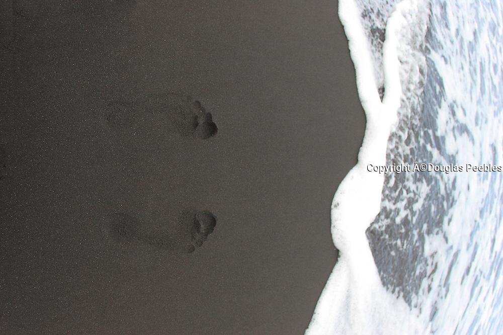 Footprints in sand, Waipio Valley, Island of Hawaii, Hawaii, USA