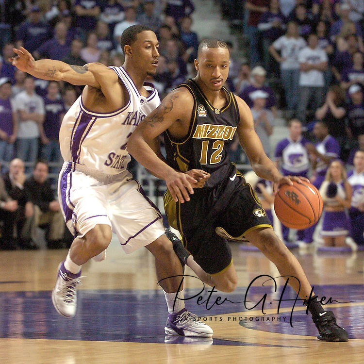Missouri guard Jason Hortin (R) drives around Kansas State guard Mario Taybron (L) during the first half of K-State's 79-64 win over the Tigers at Bramlage Coliseum in Manhattan, Kansas, January 21, 2006.