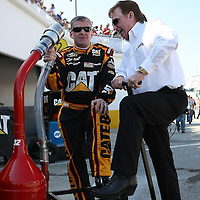 Sprint Cup Series driver Jeff Burton (31) speaks with owner Richard Childress at Daytona International Speedway on February 18, 2011 in Daytona Beach, Florida. (AP Photo/Alex Menendez)