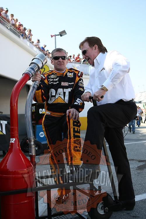 Sprint Cup Series driver Jeff Burton (31) speaks with owner Richard Childress at Daytona International Speedway on February 18, 2011 in Daytona Beach, Florida. (AP Photo/Alex Menendez)