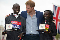HRH Prince Harry stands with the Men's and Women's Race winners Daniel Wanjiru KEN and Mary Keitany KEN. The Virgin Money London Marathon, 23rd April 2017.<br /> <br /> Photo: Jed Leicester for Virgin Money London Marathon<br /> <br /> For further information: media@londonmarathonevents.co.uk
