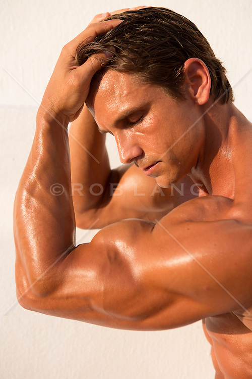 portrait of a shirtless man with great arms