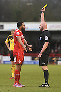Gavin Tomlin is shown the yellow card by referee Charles Breakspear during the Sky Bet League 1 match between Crawley Town and Sheffield Utd at Broadfield Stadium, Crawley, England on 28 February 2015. Photo by David Charbit.