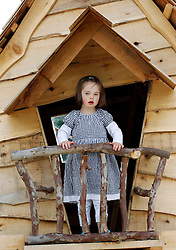 Repro Free: 30/06/2013 <br /> Cathy-May Foote (4) from Dublin 8 is pictured in the tree house at the Gardenworld Kilquade inaugural Family Garden Party in aid of Down Syndrome Ireland and Lauralynn Children's Hospice. Picture Andres Poveda