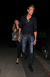 Abbey Clancy and footballer husband Peter Crouch leaving the Lemonia restaurant in Primrose Hill, London, UK. 06/08/2013 <br />BYLINE MUST READ : GOTCHAIMAGES.COM<br /><br />Copyright by © Gotcha Images Ltd. All rights reserved.<br />Usage of this image is conditional upon the acceptance <br />of Gotcha Images Ltd, terms and conditions available at<br />www.gotchaimages.com