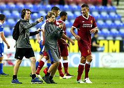 Dejan Lovren of Liverpool is asked for a selfie by fans who ran onto the pitch at the DW Stadium - Mandatory by-line: Robbie Stephenson/JMP - 14/07/2017 - FOOTBALL - DW Stadium - Wigan, England - Wigan Athletic v Liverpool - Pre-season friendly