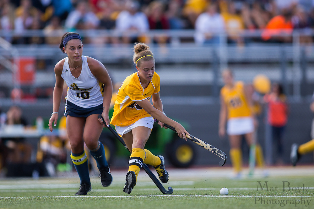 Neumann University Junior Forward Lindsey Spatola (10); Rowan University Junior Forward/Midfield Karlee Henderson (18); Rowan University Field Hockey vs Neumann University at Coach Richard Wacker Stadium in Glassboro, NJ on Saturday September 28, 2013. (photo / Mat Boyle)