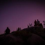 People watch stars after sunset at Glacier Point inside Yosemite National Park on Sunday, September 22, 2019 in Yosemite, California. (Alex Menendez via AP)