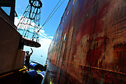 11-10-12 -   LOME, TOGO -  Preparing for crew change with the tanker ship Bonito in the Lomé anchorage in Togo, West Africa on October 12, 2011. The threat of piracy in neighbouring Benin has prompted ships to seek safer anchorage in Togolese waters, however many are concerned that pirates will follow the vessels.  Photo by Daniel Hayduk