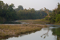 View of a tributary of the Karnali River at dusk, Bardia National Park, Nepal