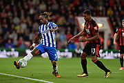 Brighton and Hove Albion defender Gaetan Bong (3) keeps the ball in play under pressure from AFC Bournemouth midfielder Jordan Ibe (33) during the EFL Cup match between Bournemouth and Brighton and Hove Albion at the Vitality Stadium, Bournemouth, England on 19 September 2017. Photo by Adam Rivers.