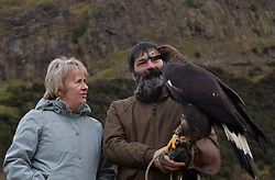 Cabinet Secretary for the Environment, Climate Change & Land Reform Roseanna Cunningham met up with an 8 month old Golden Eagle to launch the South of Scotland Golden Eagle Project, where the plan is to introduce chicks into the wild starting from next year.  The Cabinet Secretary is pictured with the eagle and it's owner Dougie McKenna.<br /> <br /> © Dave Johnston/ EEm