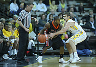 December 04 2010: Idaho State Bengals guard Broderick Gilchrest (2) tries to keep the ball away from Iowa Iowa Hawkeyes guard Eric May (25) during the first half of their NCAA basketball game at Carver-Hawkeye Arena in Iowa City, Iowa on December 4, 2010. Iowa won 70-53.
