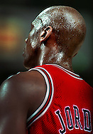 Chicago's Michael Jordan, works hard in the 4th quarter as sweat falls as the  Bulls played the Sacramento Kings at Arco Arena on Thursday, Feb. 1, 1996.