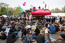 London, UK. 23rd April 2019. Climate change activists from Extinction Rebellion hold an assembly at Marble Arch during a Metropolitan Police operation to surround the stage.