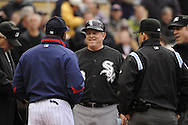 MINNEAPOLIS - MAY 12:  Third base coach Jeff Cox #6 of the Chicago White Sox meets with the umpires prior to the game against the Minnesota Twins on May 12, 2010 at Target Field in Minneapolis, Minnesota.  The Twins defeated the White Sox 3-2.  (Photo by Ron Vesely)