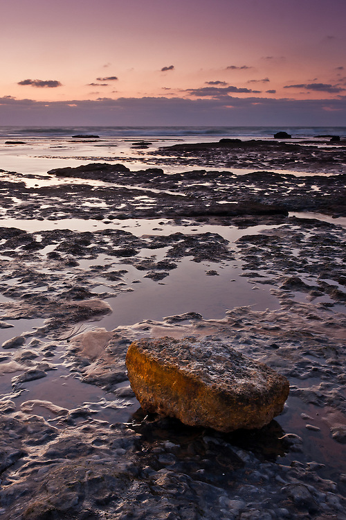In low tide, at Aguda and Magoito beaches, water left in the rocky grounds forms small tidal pools