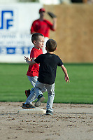 KELOWNA, BC - JULY 17: Twins begin to race the bases against each other at Elks Stadium on July 17, 2019 in Kelowna, Canada. (Photo by Marissa Baecker/Shoot the Breeze)