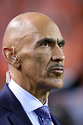 Television analyst and former NFL head coach Tony Dungy watches from the sideline during the Denver Broncos 2016 NFL week 1 regular season football game against the Carolina Panthers on Thursday, Sept. 8, 2016 in Denver. The Broncos won the game 21-20. (©Paul Anthony Spinelli)