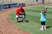 LOS ANGELES, CA - AUGUST 10:  Pitcher Kyle Kendrick #38 of the Philadelphia Phillies plays catch with a young girl before the game against the Los Angeles Dodgers on August 10, 2011 at Dodger Stadium in Los Angeles, California. The Phillies won the game 9-8. (Photo by Paul Spinelli/MLB Photos via Getty Images) *** Local Caption *** Kyle Kendrick