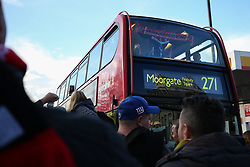 14 September 2017 - Europa League Football - Arsenal v FC Koln - A FC Koln fan holds up a scarf to the window of a double decker bus - Photo: Charlotte Wilson