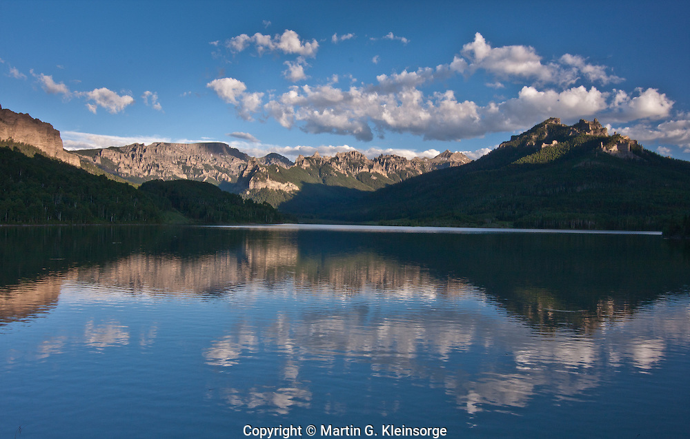 Reflections of the San Juan Mountains in Silver Jack Reservoir on the Cimarron River.  Colorado.