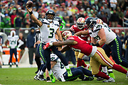 San Francisco 49ers defensive tackle DeForest Buckner (99) hits Seattle Seahawks quarterback Russell Wilson (3) during a pass attempt at Levi's Stadium in Santa Clara, Calif., on November 26, 2017. (Stan Olszewski/Special to S.F. Examiner)