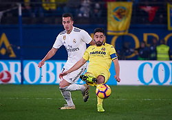January 3, 2019 - Villarreal, U.S. - VILLARREAL, SPAIN - JANUARY 03: Jaume Costa, defender of Villarreal CF competes for the ball with Lucas Vazquez, forward of Real Madrid CF during the La Liga match between Villarreal CF and Real Madrid CF at Estadio de la Ceramica on January 03, 2018 in Villarreal, Spain. (Photo by Carlos Sanchez Martinez/Icon Sportswire) (Credit Image: © Carlos Sanchez Martinez/Icon SMI via ZUMA Press)
