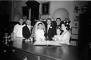 "16/09/1967<br /> 09/16/1967<br /> 16 September 1967<br /> Wedding of Mr Francis W. Moloney, 28 The Stiles Road, Clontarf and Ms Antoinette O'Carroll, ""Melrose"", Leinster Road, Rathmines at Our Lady of Refuge Church, Rathmines, with reception in Colamore Hotel, Coliemore Road, Dalkey. Image shows the Bride and Groom signing the register are the wedding. Second from left is Michael Power and on right is Gladys McGloughlin."