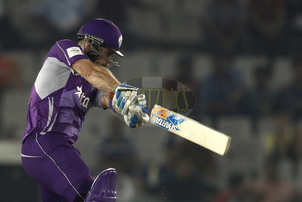 Aiden Blizzard of the Hobart Hurricanes square drives a delivery during match 2 of the Oppo Champions League Twenty20 between the Kings XI Punjab and the Hobart Hurricanes held at the Punjab Cricket Association Stadium, Mohali, India on the 18th September 2014<br /> <br /> Photo by:  Shaun Roy / Sportzpics/ CLT20<br /> <br /> <br /> Image use is subject to the terms and conditions as laid out by the BCCI/ CLT20.  The terms and conditions can be downloaded here:<br /> <br /> http://sportzpics.photoshelter.com/gallery/CLT20-Image-Terms-and-Conditions-2014/G0000IfNJn535VPU/C0000QhhKadWcjYs