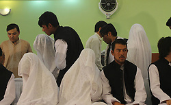 60354096 <br /> Couples attend a mass charity wedding ceremony in Balkh province, northern Afghanistan, on August 13, 2013. Charities organised the mass wedding for some 52 couples to help who are unable to afford individual ceremonies.<br /> Balkh province, northern Afghanistan, Wednesday August 13, 2013.<br /> Picture by imago / i-Images<br /> UK ONLY