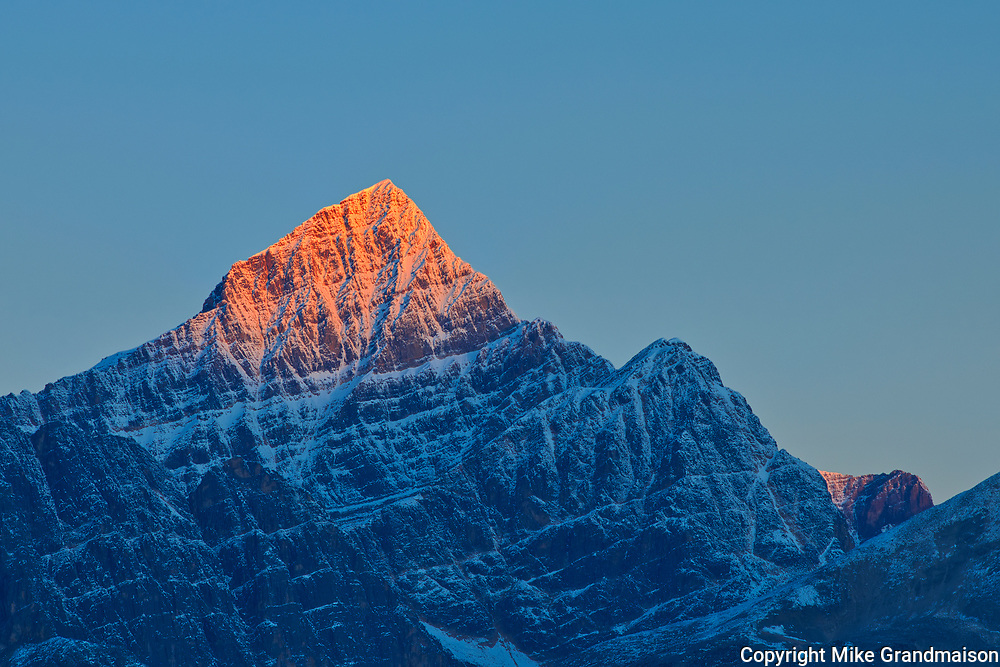 First light on a peak of the Canadina Rocky Mountains. Icefields Parkway.<br />