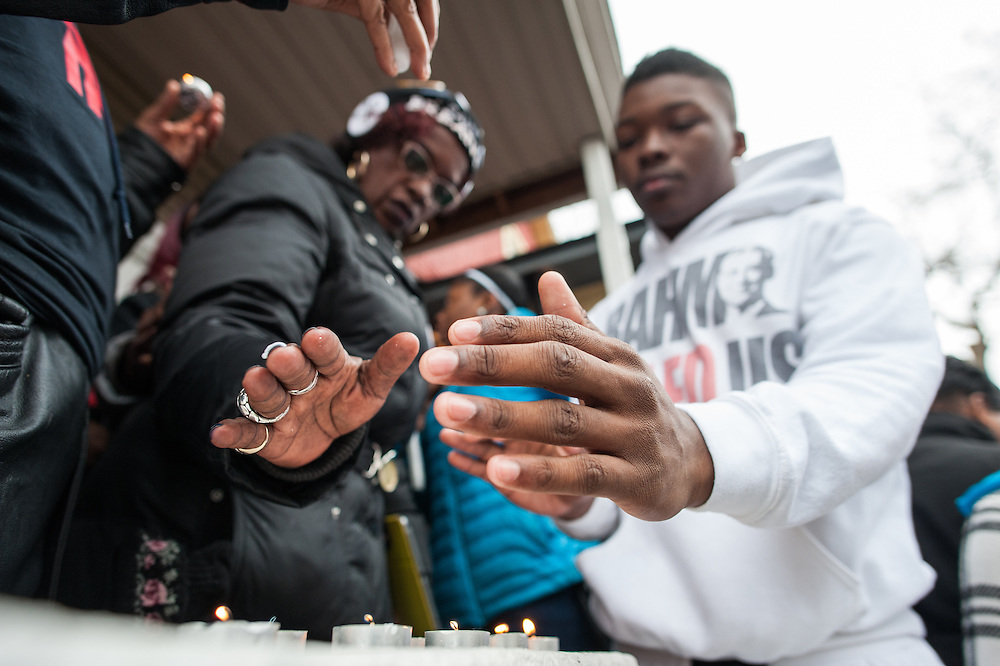 Friends and family of Quintonio LeGrier and Bettie Jones including Ja'Mal Green light candles during a vigil for the West Side residents who were shot and killed by Chicago Police on the morning of December 26, 2015.