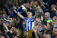 Brighton fans celebrate on the final whistle during the Premier League match between Brighton and Hove Albion and Manchester United at the American Express Community Stadium in Brighton and Hove. 04 May 2018