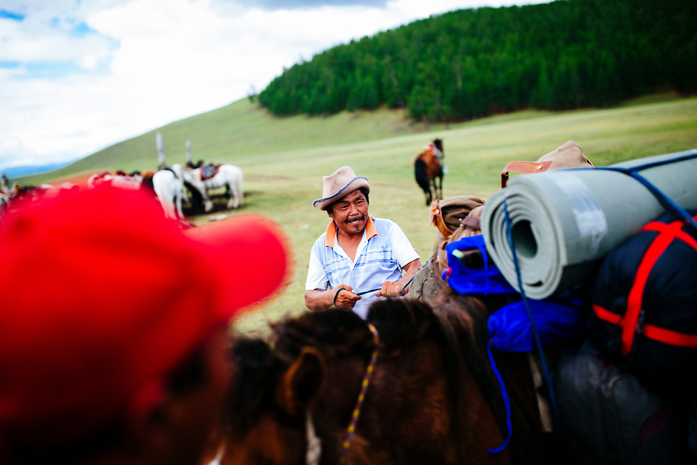 Men prepare horses for a long journey into the East Taiga forests of northern Mongolia.