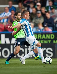Harry Arter of Cardiff City (L) and Jonathan Hogg of Huddersfield Town in action - Mandatory by-line: Jack Phillips/JMP - 25/08/2018 - FOOTBALL - The John Smith's Stadium - Huddersfield, England - Huddersfield Town v Cardiff City - English Premier League