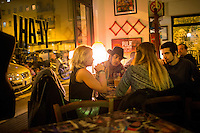 Rome, Italy - December 12, 2014: A group of friends chat at Yeah Pigneto, in the hip neighborhood that shares the same name in Rome. CREDIT: Chris Carmichael for The New York Times