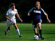 4 MAY 2010 -- ST. LOUIS -- St. Dominic High Shool girls' soccer player     Jacey Boyko (18) pushes the ball upfield past Visitation Academy's Janey Roope (3) during a game between the two schools Tuesday, May 4, 2010 at Visitation in St. Louis. Visitation won the match, 2-1. Photo © copyright 2010 by Sid Hastings.