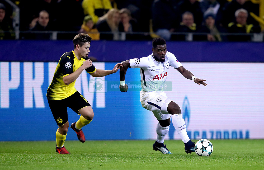 Borussia Dortmund's Raphael Guerreiro and Tottenham Hotspur's Serge Aurier (right) battle for the ball