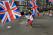 Children run in an egg and spoon race at a neighbourhood street party in Dulwich, south London celebrating the Diamond Jubilee of Queen Elizabeth. A few months before the Olympics come to London, a multi-cultural UK is gearing up for a weekend and summer of pomp and patriotic fervour as their monarch celebrates 60 years on the throne and across Britain, flags and Union Jack bunting adorn towns and villages.