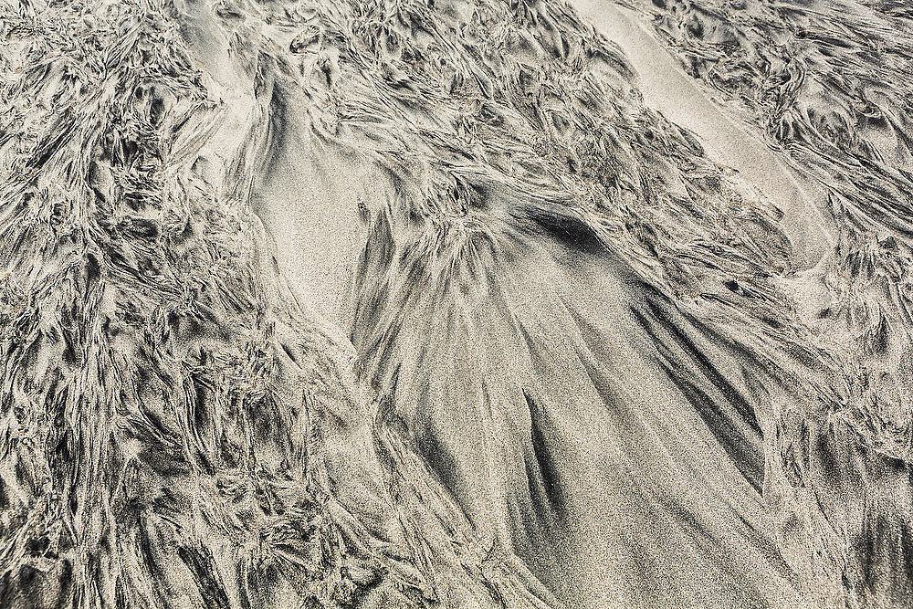 Ripple patterns caused by sediment transport by water in the sand on Bunes Beach, Moskenesoya, Lofoten Islands, Norway.