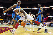 April 13, 2011; Cleveland, OH, USA; Cleveland Cavaliers point guard Daniel Gibson (1) looses control of the ball as he drives past Washington Wizards forward Kevin Seraphin (13) during the second quarter at Quicken Loans Arena. Mandatory Credit: Jason Miller-US PRESSWIRE