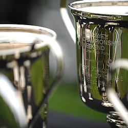 Trophies await their winners during the Grand-Am Rolex Sports Car Series Championship Race at Lime Rock Park in Lakeville, Conn.