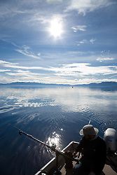 """Fishing on Lake Tahoe 4"" - This man was photographed fishing for Mackinaw near the West shore of Lake Tahoe, California."