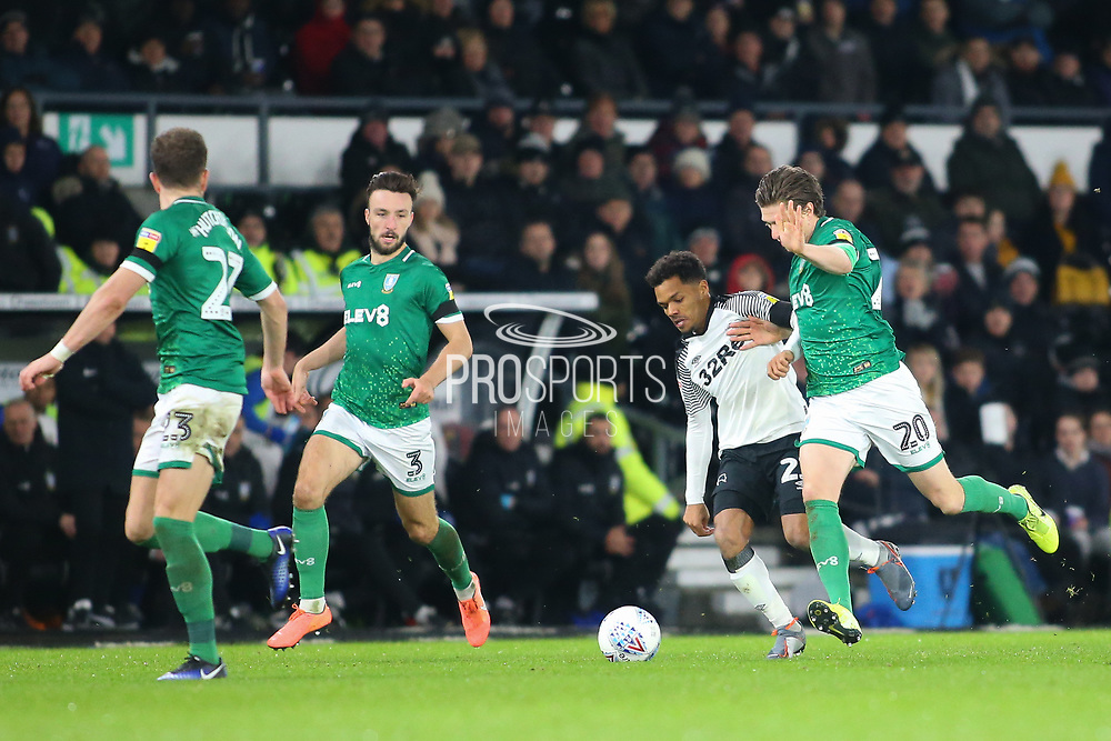 Derby County midfielder Duane Holmes (23) is challenged for the ball by Sheffield Wednesday midfielder Adam Reach (20) during the EFL Sky Bet Championship match between Derby County and Sheffield Wednesday at the Pride Park, Derby, England on 11 December 2019.