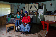 The Mijkelo family has lived in a cottage at the bottom of their employer&rsquo;s garden for 15 years. If their employment ends they will need to find another home. <br /> <br /> During Apartheid the workers in the mountain retreat town of Hogsback were not allowed to own their own property. They had to reside on their employer&rsquo;s properties or commute from the Ciskei homeland in the valley below.<br /> <br /> Since the early 1990&rsquo;s the workers in Hogsback have been trying to get the go ahead for a low cost housing development but continue to face delays and legal challenges. The Legal Resources Centre is representing the Hogsback workers in negotiations to find a suitable site for the low cost housing development.<br /> <br /> &copy;Zute &amp; Demelza Lightfoot / Legal Resources Centre