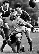 Michael Speight in action as Wayne Buck Shelford and McDowell look on, rugby union. Date Unknown. Photographer Unknown.
