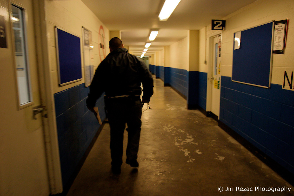 UK ENGLAND NOTTINGHAM 14DEC04 - Prison guard Craig walks through a long corridor at HMP Lowdham Grange in Nottinghamshire. This newly-built prison is entirely run and controlled by private company Premier-Serco on contract from the Home Office since 1998. The facility holds over 500 Category-B and C inmates with an minimum sentence of 4 years.....jre/Photo by Jiri Rezac....© Jiri Rezac 2004....Contact: +44 (0) 7050 110 417..Mobile:  +44 (0) 7801 337 683..Office:  +44 (0) 20 8968 9635....Email:   jiri@jirirezac.com..Web:     www.jirirezac.com....© All images Jiri Rezac 2004 - All rights reserved.