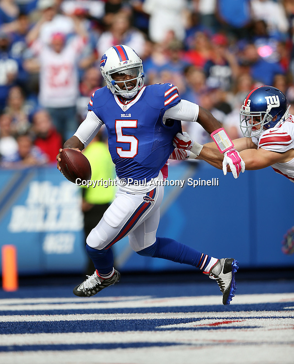 Buffalo Bills quarterback Tyrod Taylor (5) scrambles away from defensive pressure and a near sack by New York Giants safety Craig Dahl (43) in his own end zone in the third quarter during the 2015 NFL week 4 regular season football game against the New York Giants on Sunday, Oct. 4, 2015 in Orchard Park, N.Y. The Giants won the game 24-10. (©Paul Anthony Spinelli)