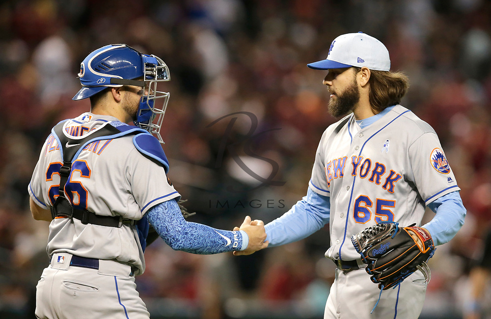 New York Mets pitcher Robert Gsellman (65) celebrates with Kevin Plawecki after defeating the Arizona Diamondbacks 5-3 during a baseball game, Sunday, June 17, 2018, in Phoenix. (AP Photo/Rick Scuteri)